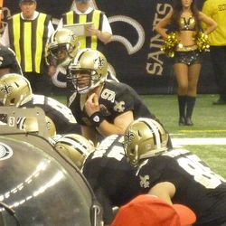 Drew Brees cancelling a play at the line of scrimmage.