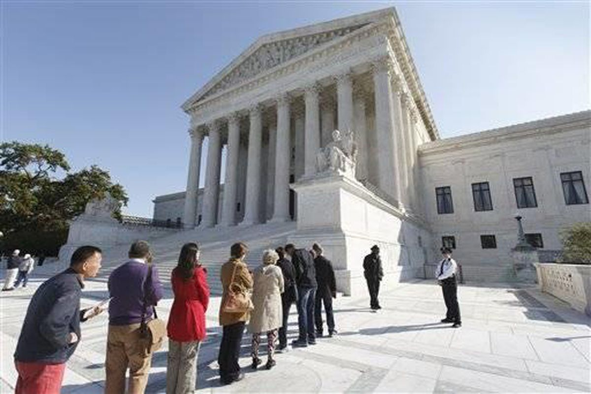 People wait to enter the Supreme Court in Washington, Monday, Oct. 6, 2014, as it begins its new term. The justices cleared the way Monday for an immediate expansion of same-sex marriage by unexpectedly and tersely turning away appeals from five states se