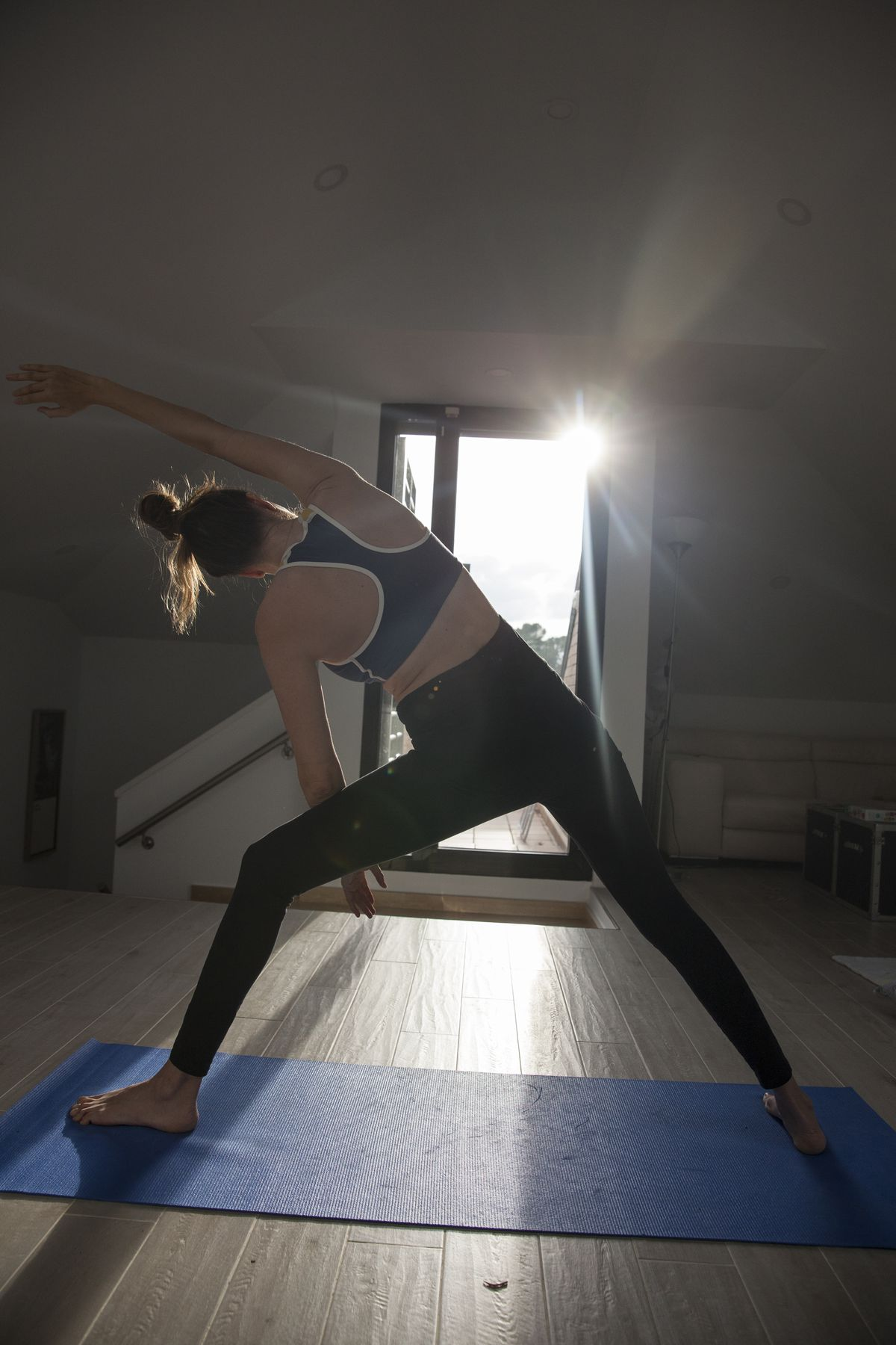 Woman practicing yoga during Covid lockdown