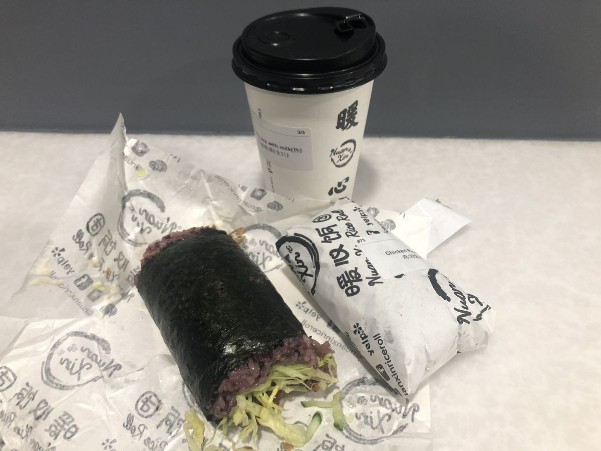 The roasted duck roll, plus a second wrapped roll and hot drink from Nuan Xin, in Manhattan's Chinatown