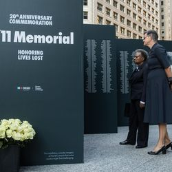 Chicago Mayor Lori Lightfoot and First Lady Amy Eshleman look at the temporary 9/11 memorial during the commemoration of the 20th anniversary of 9/11 at the Richard J. Daley Plaza, Saturday morning, Sept. 11, 2021.