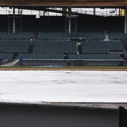 Grounds crew watering the field. Viewed through Gate Q -