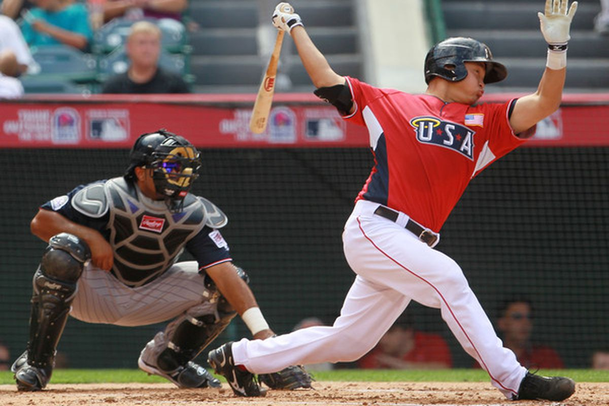 ANAHEIM CA - JULY 11:  U.S. Futures All-Star Hank Conger #24 of the Los Angeles Angels of Anaheim at bat during the 2010 XM All-Star Futures Game at Angel Stadium of Anaheim on July 11 2010 in Anaheim California.  (Photo by Jeff Gross/Getty Images)