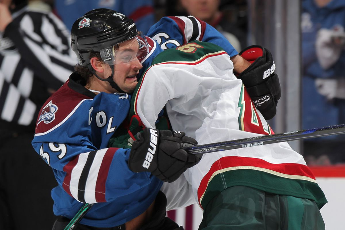 DENVER, CO - FEBRUARY 02:  T.J. Galiardi #39 of the Colorado Avalanche tries to battle his way past Jared Spurgeon #46 of the Minnesota Wild at the Pepsi Center on February 2, 2012 in Denver, Colorado.  (Photo by Doug Pensinger/Getty Images)