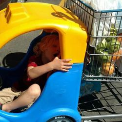 Arianne Brown's 4-year-old son, Axel, cries in the car cart at the local grocery store.