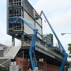 11:14 a.m. Working on the right-field video board -
