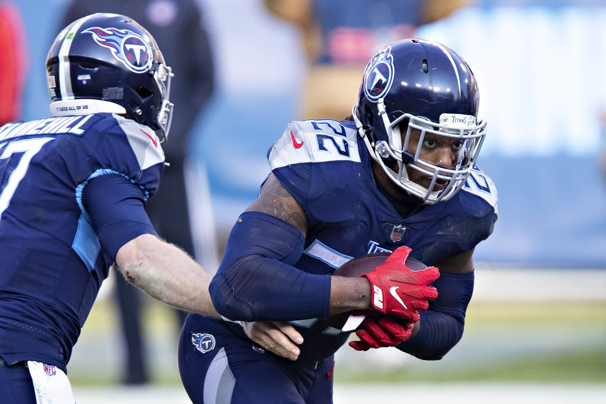 Quarterback Ryan Tannehill #17 hands off the ball to running back Derrick Henry #22 of the Tennessee Titans during their AFC Wild Card Playoff game against the Baltimore Ravens at Nissan Stadium on January 10, 2021 in Nashville, Tennessee. The Ravens defeated the Titans 20-13.