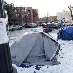 A notice indicating that it is unlawful to camp in the area is posted next to tents on 500 South beside Library Square in Salt Lake City on Tuesday, Nov. 26, 2019.