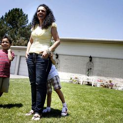 """Jonah, 7, Jessica and Ellie, 5, speak to the media about being selected to receive a brand new home from """"Extreme Makeover: Home Edition"""" in Taylorsville on Thursday, June 23, 2011.  The Gomez family's new home will be built in Draper."""