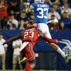 Brigham Young Cougars wide receiver Beau Tanner (33) pulls in a pass above Utah Utes defensive back Julian Blackmon (23) at LaVell Edwards Stadium in Provo on Saturday, Sept. 9, 2017.