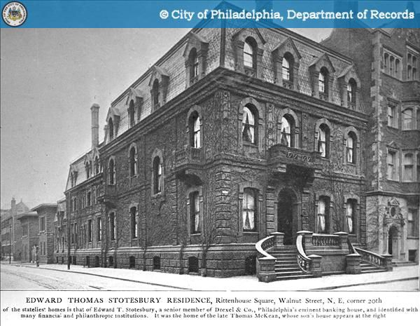 The exterior of the McKean Townhouses in Philadelphia. The building has a staircase leading to the entryway and multiple windows. This is an old black and white photograph.