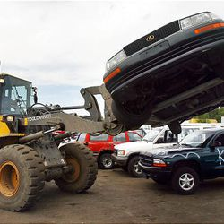 Cash for clunkers cars are crushed at Tear A Part auto recycling in Salt Lake City.