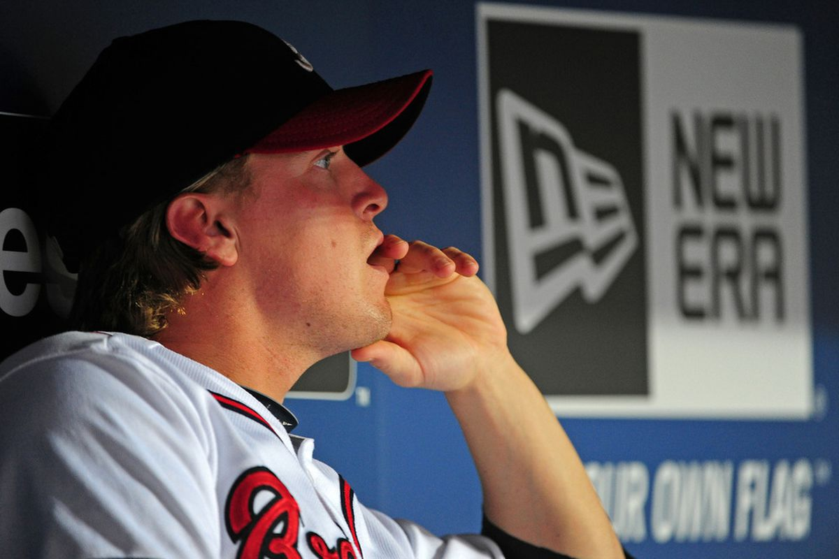 ATLANTA - SEPTEMBER 27: Nate McLouth #13 of the Atlanta Braves watches play late in the game against the Philadelphia Phillies at Turner Field on September 27, 2011 in Atlanta, Georgia. (Photo by Scott Cunningham/Getty Images)