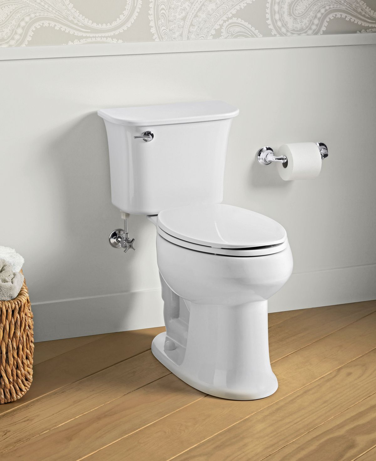 Two piece toilet with elongated bowl.