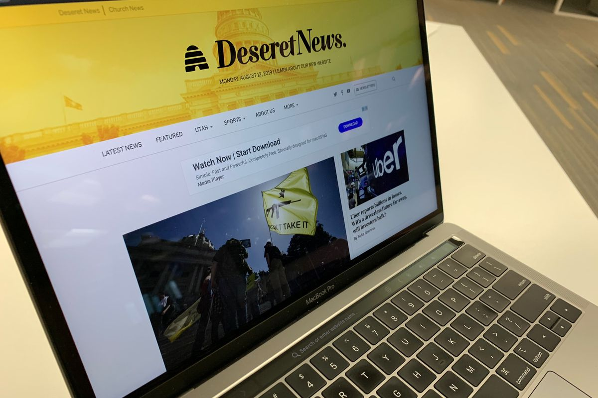 A photo of the new Deseret News website shown on a MacBook Pro.