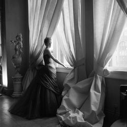 """Nancy James in James's """"Swan"""" gown, 1955, photographed by Cecil Beaton."""