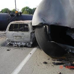 This June 20, 2009 photo provided by the National Transportation Safety Board shows the aftermath of a train derailment near Rockford, Ill. The most common cause of ethanol release in this accident was tank head failure on the tanker seen at right, known as a DOT-111, due to impacts received from couplers and draft sills of adjacent tank cars. For two decades, rail tankers designated as DOT-111, a workhorse of the American rail fleet, have been allowed to haul hazardous liquids from coast to coast even though transportation officials were aware of a dangerous design flaw that almost guarantees the car will tear open in an accident.