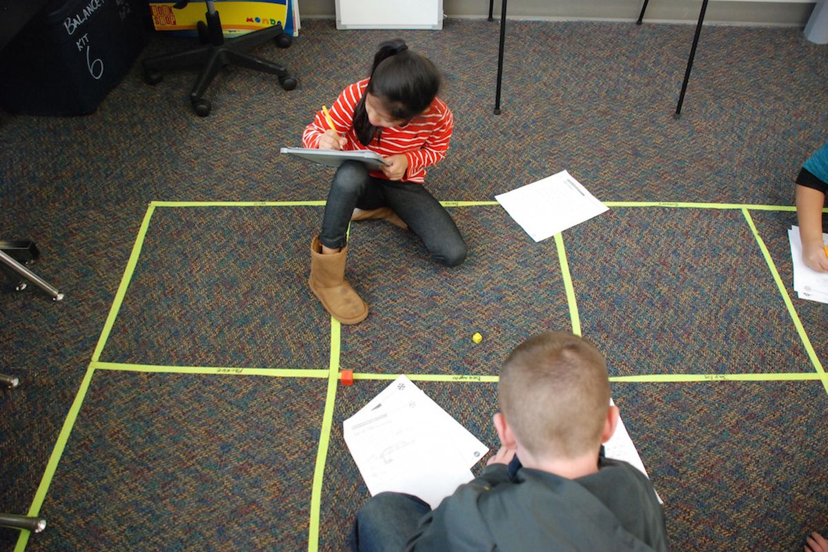 Students at Vista PEAK Exploratory in Aurora work on a math assignment. (Photo by Nic Garcia)