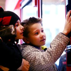 Schroeder and Hudson Ryan make their selections from the many different items inside a Light the World charity vending machine. They and their parents, Brittany and Travis Ryan, joined other visitors to the Joseph Smith Memorial Building in Salt Lake City on Friday, Dec. 15, 2017.
