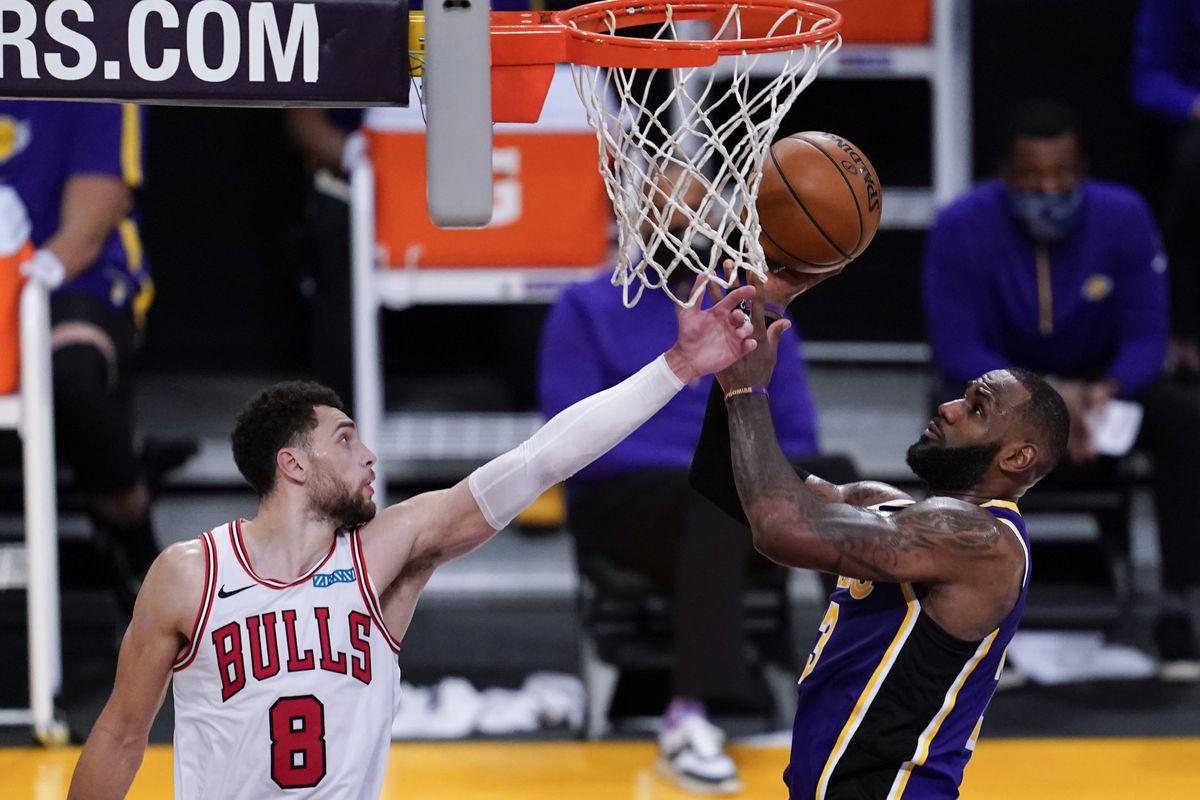 Bulls guard Zach LaVine defends against the Lakers' LeBron James.