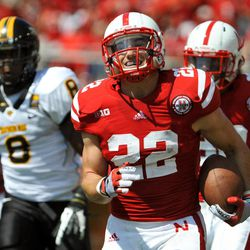 Nebraska's Rex Burkhead (22) smiles during a 57-yard touchdown run during against Southern Miss during an NCAA college football game, Saturday, Sept. 1, 2012, in Lincoln, Neb.