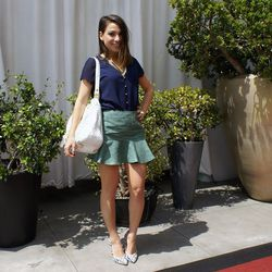 """<a href=""""http://simplystylist.com/""""target=""""_blank"""">Simply Stylist</a> founder Sarah Boyd wearing a Cooper & Ella top, a Harlyn skirt, an Elliott Luca bag, Joe's Jeans shoes and jewelry from her <a href=""""http://la.racked.com/archives/2014/01/27/simply_styl"""