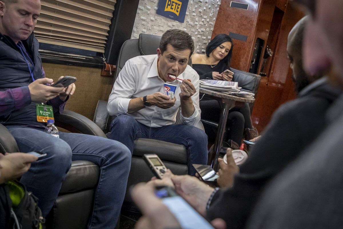 Buttigieg eating a soft serve ice cream.