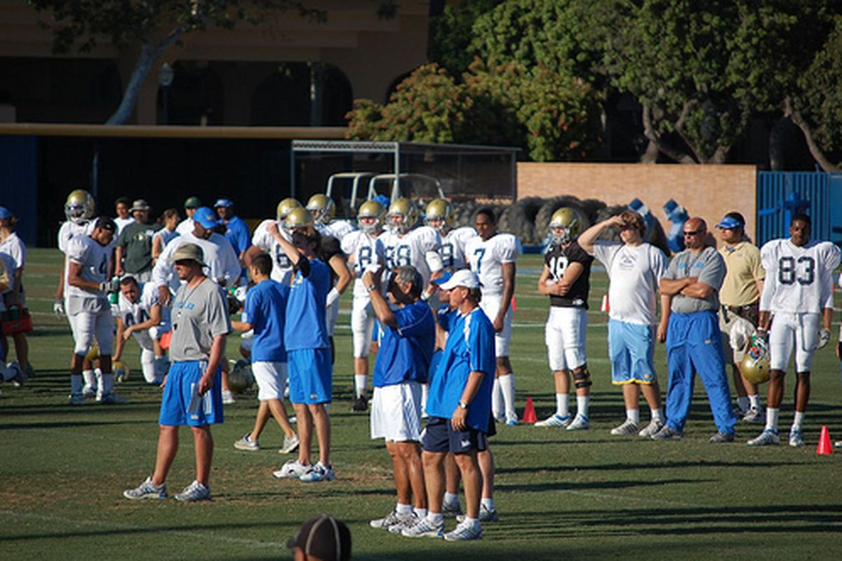 """<em>Norm Chow digs Bruin Blue and Rick Neuheisel's leadership at UCLA. Photo Credit: <a href=""""http://www.flickr.com/photos/evang/3463994761/"""" target=""""new"""">Evan G (flickr)</a></em>"""