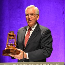 From a lantern, Elder D. Todd Christofferson of the Quorum of the Twelve Apostles of The Church of Jesus Christ of Latter-day Saints pulled a flash drive containing names and information about 1.8 million of the 4 million people who were enslaved before the Civil War. He presented the database to the Smithsonian's National Museum of African American History and Culture on Tuesday, Dec. 6, 2016.