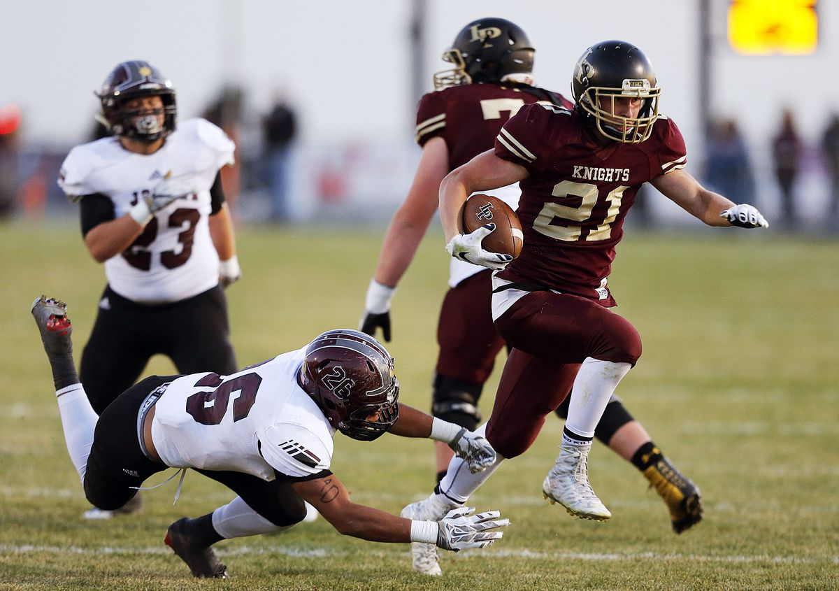 Jackson McChesney of Lone Peak runs for a touchdown during 5A high school football action in Highland on Friday, Nov. 4, 2016.