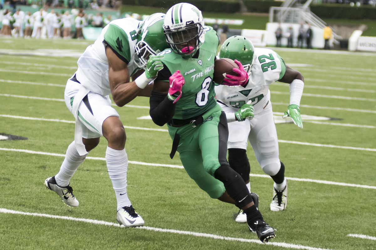 Remi Watson (8) rushes for a big gain over North Texas.