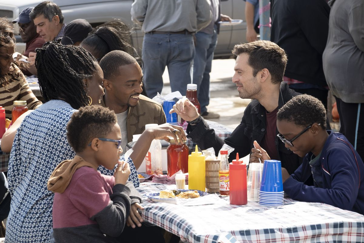 arah Wilson (Adepero Oduye), Falcon/Sam Wilson (Anthony Mackie) and Winter Soldier/Bucky Barnes (Sebastian Stan) have dinner on the dock in Falcon and the Winter Soldier