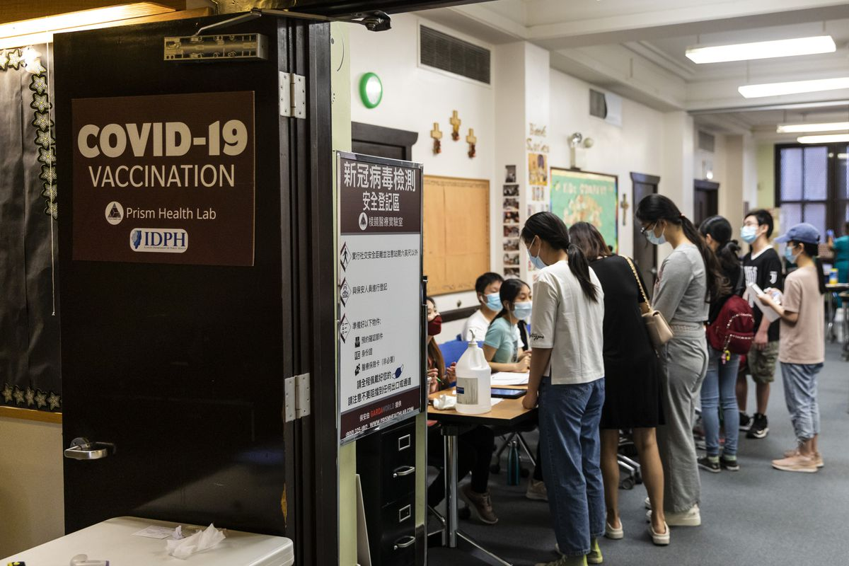 People line up to receive a dose of a COVID-19 vaccine at Pui Tak Center in Chinatown, Monday afternoon, June 28, 2021. | Ashlee Rezin Garcia/Sun-Times