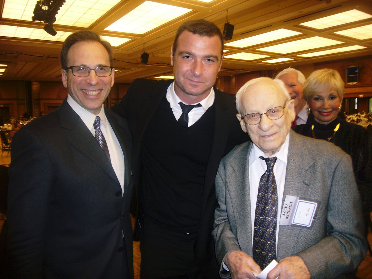 """WWII partisan fighter Leon Figa (right) with his son Stewart Figa, left, and actor Liev Schrieber, who portrayed a member of the resistance in the 2008 film """"Defiance."""" 