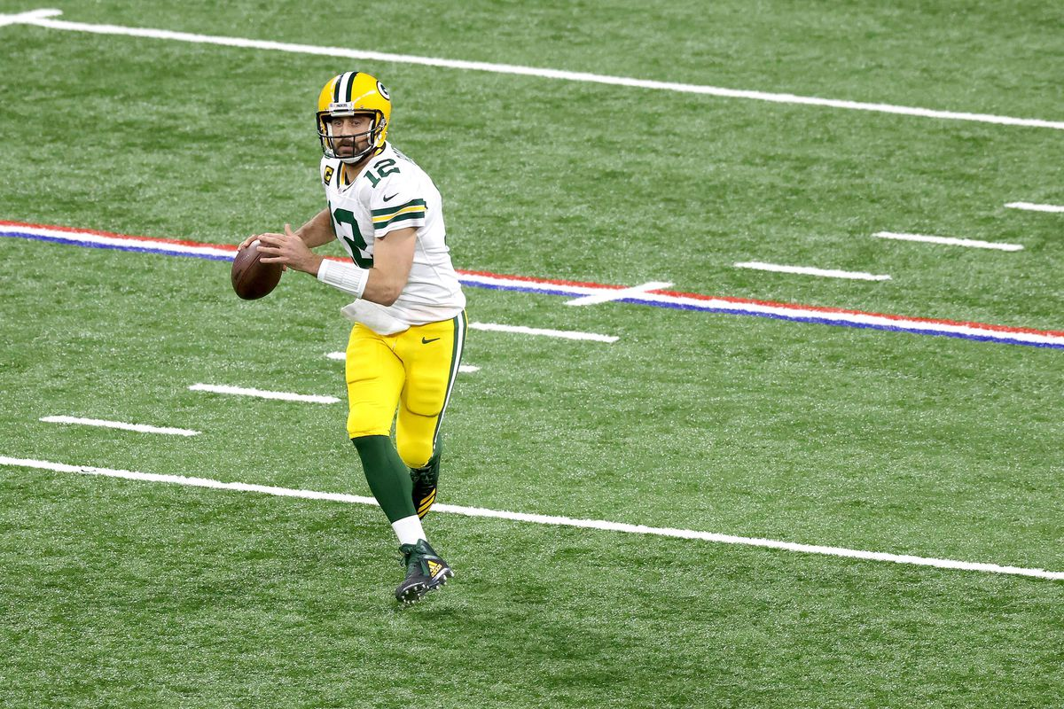Aaron Rodgers #12 of the Green Bay Packers runs with the ball against the Indianapolis Colts during the game at Lucas Oil Stadium on November 22, 2020 in Indianapolis, Indiana.