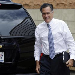 Republican presidential candidate Mitt Romney arrives at his campaign headquarters in Boston, to prepare for the presidential debates, Sunday, Sept. 9, 2012.
