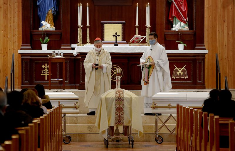 Cardinal Blase Cupich and the Rev. Esequiel Sanchez presided over the funeral Mass Wedneday for the four young girls and their mother killed in a Des Plaines house fire.