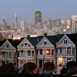 In this Monday, May 12, 2008, photo, a row of historical Victorian homes, underscore the San Francisco skyline in a view from Alamo Square,Calif. Apartment rents in San Francisco have soared beyond the lofty levels of the original Internet boom more than a decade ago. This time, it's being driven by well-paid software engineers and Web designers who are flocking to Silicon Valley.
