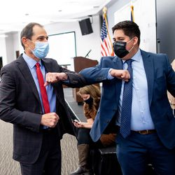 Rep. John Curtis, R-Utah, who is competing to hold his seat in the 3rd Congressional District, left, greets Utah Republican Party staffer Abe Vazquez at an election night event for Republican candidates in at the Utah Association of Realtors building in Sandy on Tuesday, Nov. 3, 2020.