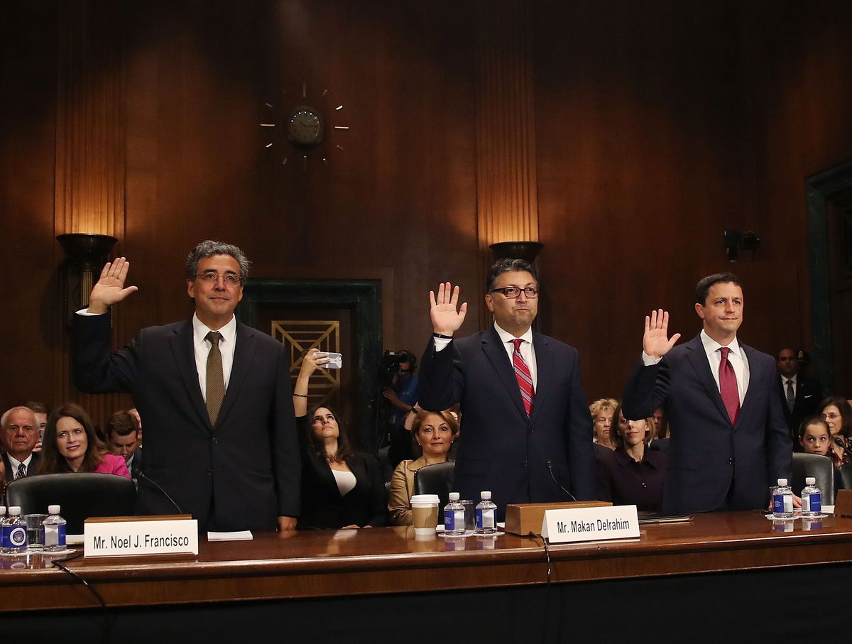 Noel Francisco, Makan Delrahim and Steven Engel hold up their right hands to be sworn in by the Senate Judiciary Committee