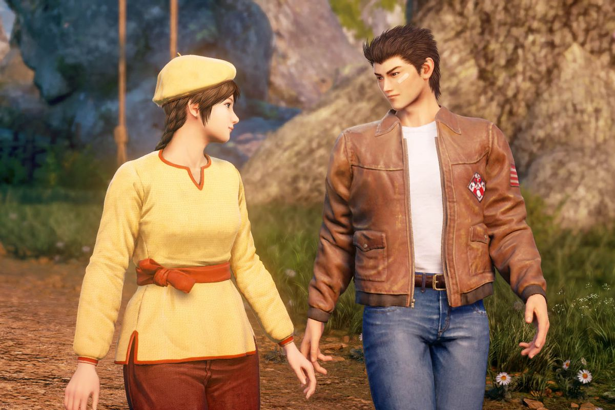 A young man and woman look at each other, hands nearly touching