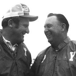 BYU head football coach LaVell Edwards talks with golfer Billy Casper in 1976.