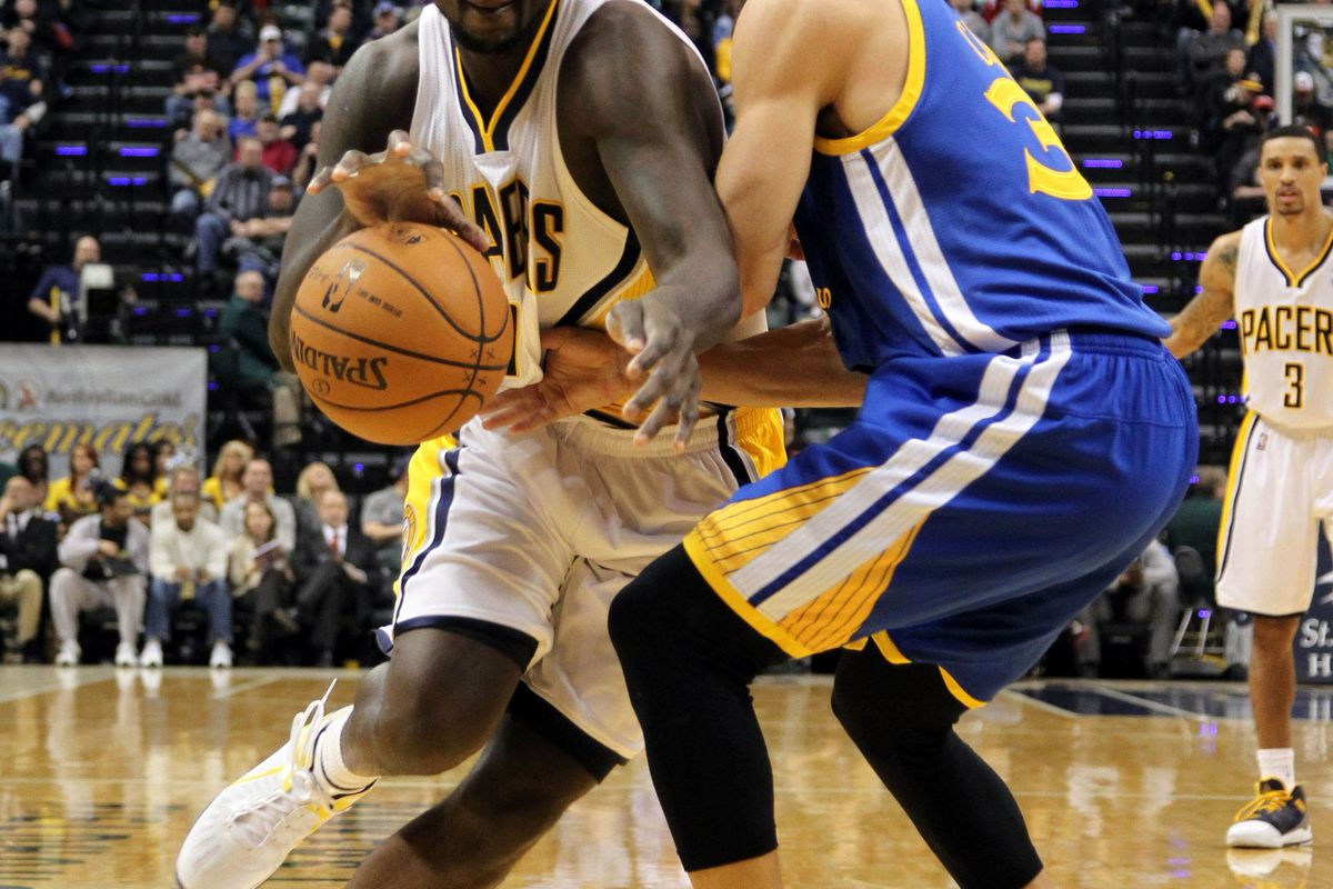 Lance Stephenson tries to get by Stephen Curry