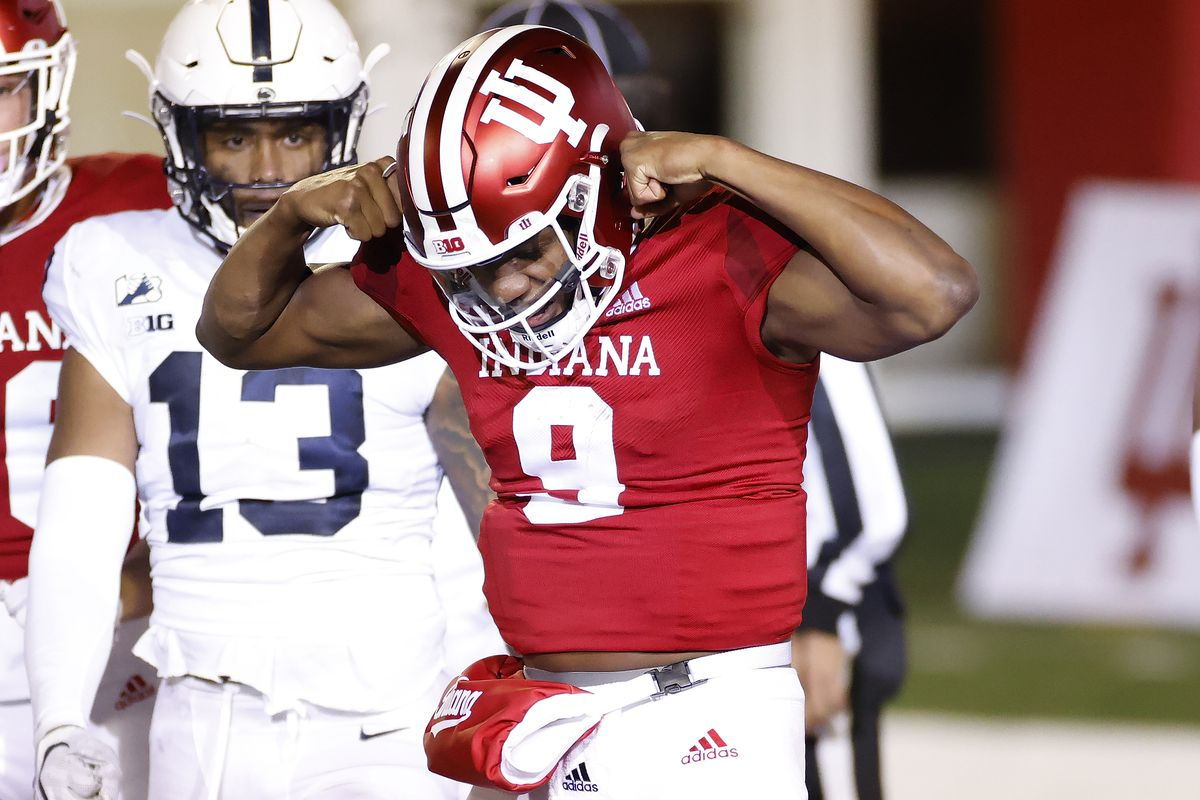Michael Penix Jr. of the Indiana Hoosiers reacts over Lamont Wade of the Penn State Nittany Lions after rushing for the game-tying touchdown in the fourth quarter at Memorial Stadium on October 24, 2020 in Bloomington, Indiana. Indiana won 36-35 in overtime.