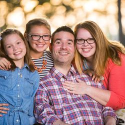 Vance Taylor poses with his wife Casey, right, and their daughters Isabelle and Sammy.