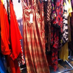 The backgammon maxi dress in the sample area is $300