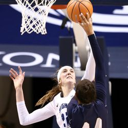 FILE: Brigham Young Cougars center Sara Hamson (22) blocks Montana State Bobcats forward Blaire Braxton (44) as BYU and Montana State women play an NCAA basketball game in Provo at the Marriott Center on Friday, Dec. 22, 2017.