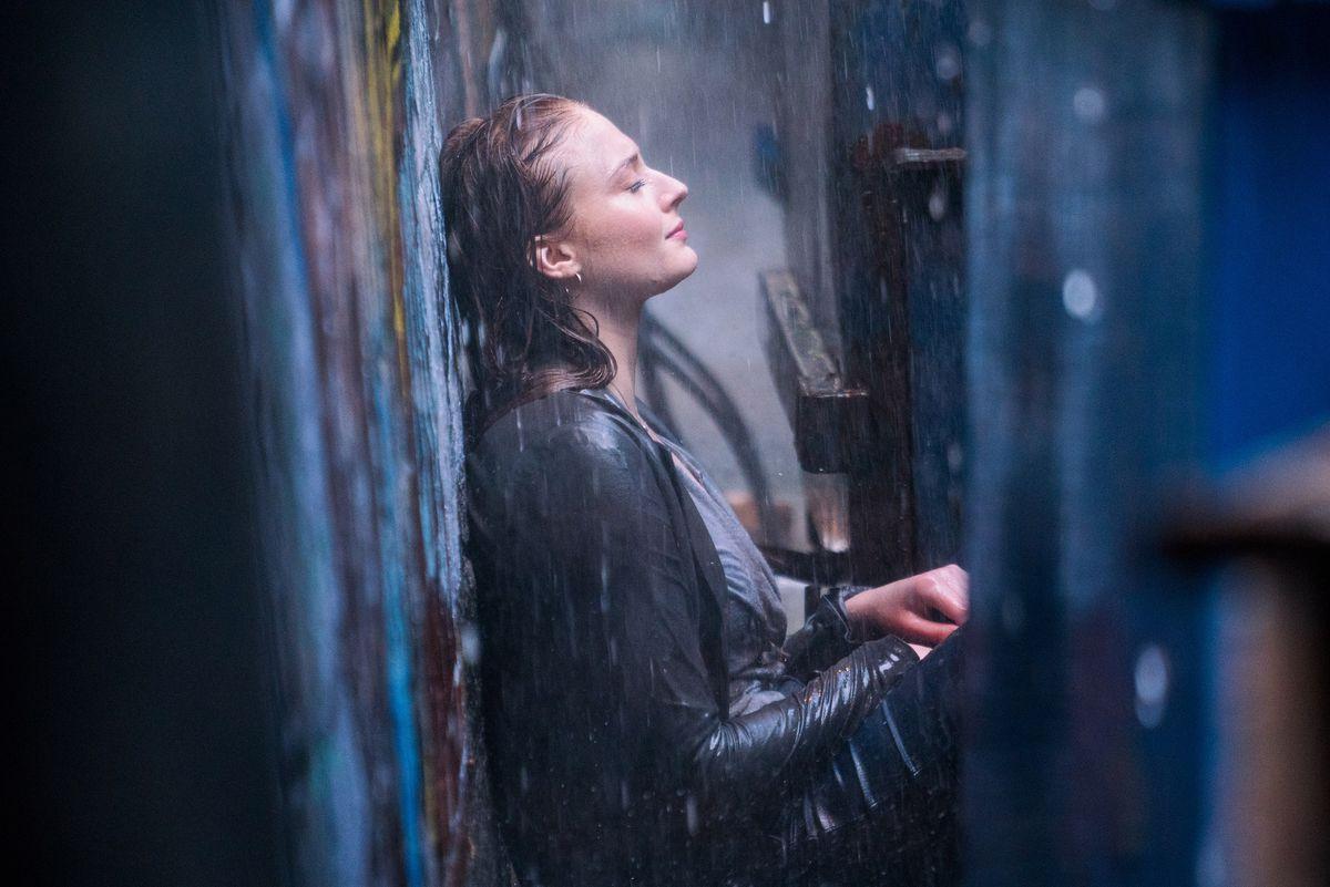 Dark Phoenix - Jean Grey sits in the rain