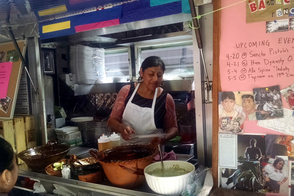 Co-owner Cristina Martinez serves customers this past weekend at Eighth and Watkins.
