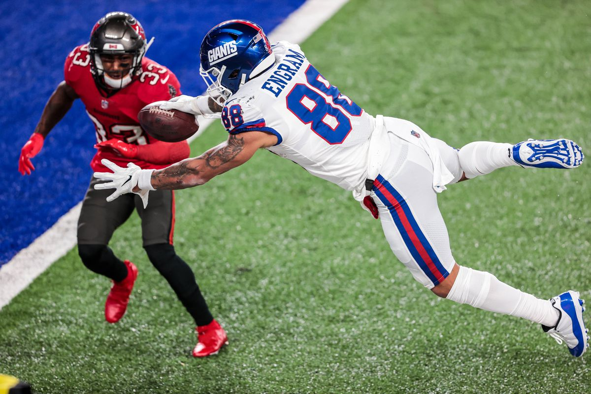 New York Giants tight end Evan Engram (88) dives for the end zone as Tampa Bay Buccaneers free safety Jordan Whitehead (33) defends during the first half at MetLife Stadium.